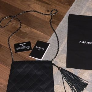 Black satin quilt pattern Chanel crossbody bag